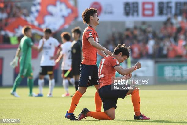Keisuke Oyama and Yuzo Iwakami of Omiya Ardija celebrate victory during the JLeague J1 match between Omiya Ardija and Urawa Red Diamonds at Nack 5...