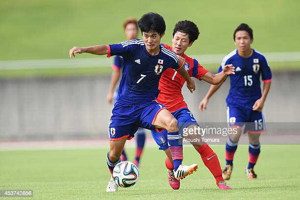 Keisuke Oyama of Japan is challenged by Jeongbin Lee of South Korea in the U19 match between South Korea and Japan during SBS Cup International Youth...