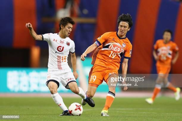 Keisuke Oyama of Omiya Ardija controls the ball under pressure of Kisho Yano of Albirex Niigata during the JLeague J1 match between Albirex Niigata...