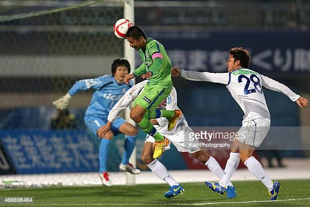 Keisuke Tsuboi of Shonan Bellmare scores his team's first goal during the JLeague Yamazaki Nabisco Cup match between Shonan Bellmare and Ventforet...