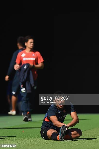 Keisuke Uchida warms up during Japan Captain's Run at Nissan Stadium on November 3 2017 in Yokohama Kanagawa Japan