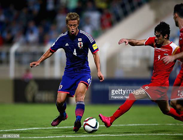 Keisuku Honda of Japan in action during the 2018 FIFA World Cup Asian Group E qualifying match between Syria and Japan at Seeb Stadium on October 8...