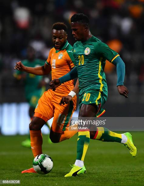 Keita Balde of Senegal holds off Cheick Doukoure of the Ivory Coast during the International Friendly match between the Ivory Coast and Senegal at...