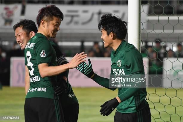 Keita Goto of Matsumoto Yamaga celebrates scoring his side's third goal with his team mate Hiroyuki Takasaki during the JLeague J2 match between...