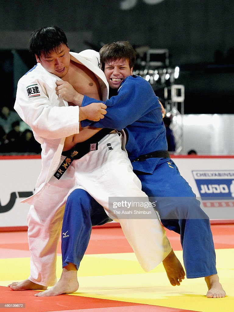 Keita Iwao (white) of Japan and <a gi-track='captionPersonalityLinkClicked' href=/galleries/search?phrase=Ryu+Shichinohe&family=editorial&specificpeople=9207686 ng-click='$event.stopPropagation()'>Ryu Shichinohe</a> (blue) of Japan compete in the Men's +100kg bronze medal match during day three of the Judo Grand Slam Tokyo 2014 at Tokyo Metropolitan Gymnasium on December 7, 2014 in Tokyo, Japan.