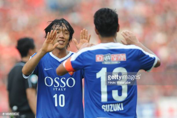 Keita Suzuki of Blue Friends celebrates scoring his team's first goal during the Keita Suzuki testimonial match between Reds Legends and Blue Friends...