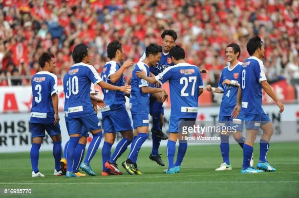 Keita Suzuki of Blue Friends celebrates scoring his team's third goal during the Keita Suzuki testimonial match between Reds Legends and Blue Friends...