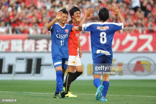 Keita Suzuki of Blue Friends celebrates scoring his team'sfirst goal during the Keita Suzuki testimonial match between Reds Legends and Blue Friends...