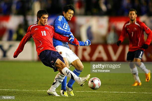 Keita Suzuki of Japan and Pedro Morales of Chile in action during international friendly match between Japan and Chile at the National Stadium on...