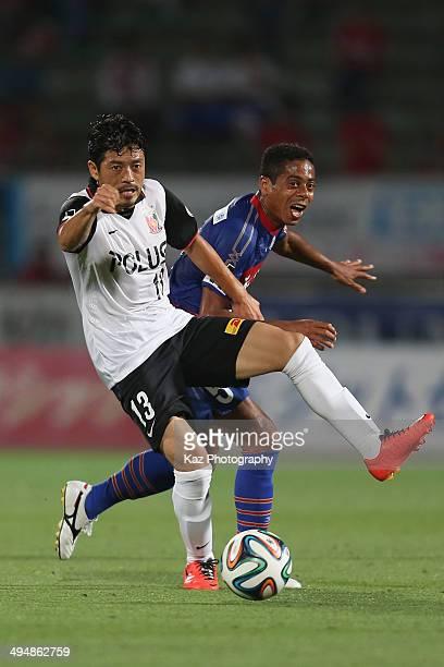 Keita Suzuki of Urawa Red Diamonds and Marquinhos Parana whose real name is Antonio Marcos da Silva Filho of Ventforet Kofu compete for the ball...