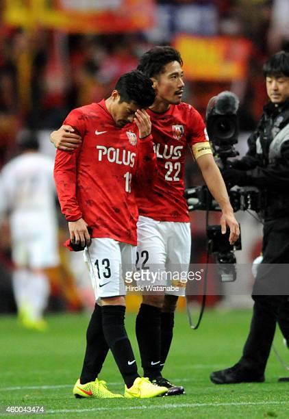 Keita Suzuki of Urawa Red Diamonds is consoled by Yuki Abe after the 12 defeat in the JLeague match between Urawa Red Diamonds and Nagoya Grampus at...