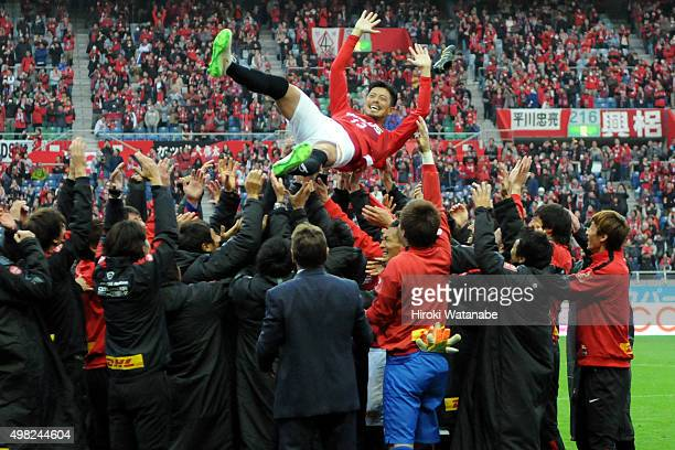 Keita Suzuki of Urawa Red Diamonds is thrown into the air during his retirement ceremony after the JLeague match between Urawa Red Diamonds and...
