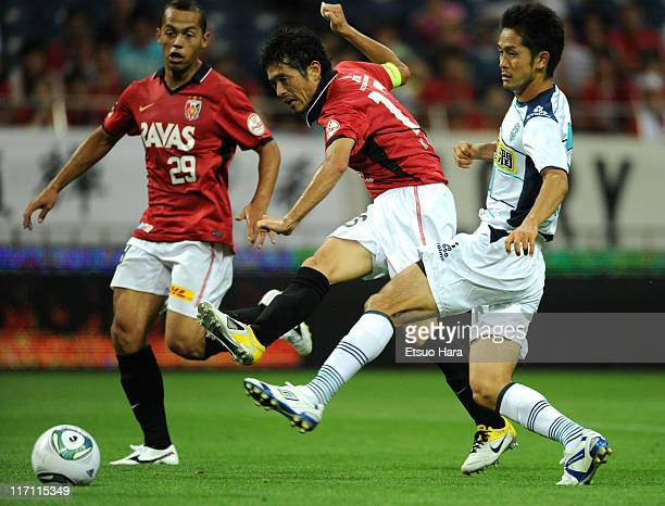 Keita Suzuki of Urawa Red Diamonds scores the first goal during the JLeague match between Urawa Red Diamonds and Avispa Fukuoka at Saitama Stadium on...