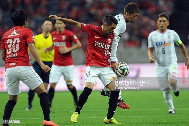 Keita Suzuki of Urawa Reds and Kazuyuki Morisaki of Sanfrece Hiroshima compete for the ball during the JLeague Yamazaki Nabisco Cup quarter final...