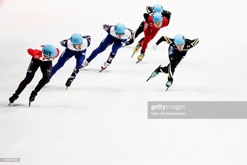 Keita Watanabe (R) of Japan, Alexander Fathoullin L) of Canada, <a gi-track='captionPersonalityLinkClicked' href=/galleries/search?phrase=Semen+Elistratov&family=editorial&specificpeople=8823657 ng-click='$event.stopPropagation()'>Semen Elistratov</a> (2nd from L) of Russia, <a gi-track='captionPersonalityLinkClicked' href=/galleries/search?phrase=Ruslan+Zakharov&family=editorial&specificpeople=4114906 ng-click='$event.stopPropagation()'>Ruslan Zakharov</a> (C) of Russia, Kai An of China and Yoshiaki Oguro (back) of Japan competes in the mens 1500m semi finals during ISU Short Track Speed Skating World Cup held at The Sportboulevard on February 13, 2016 in Dordrecht, Netherlands.