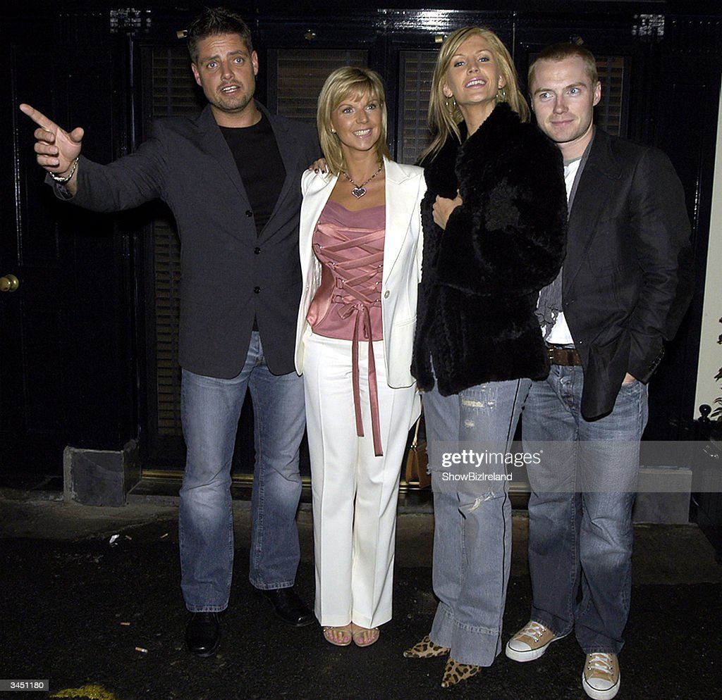 Keith and Lisa Duffy stand with Yvonne and Ronan Keating outside Diep Shaker Restaurant April 20, 2004 in Dublin, Ireland.