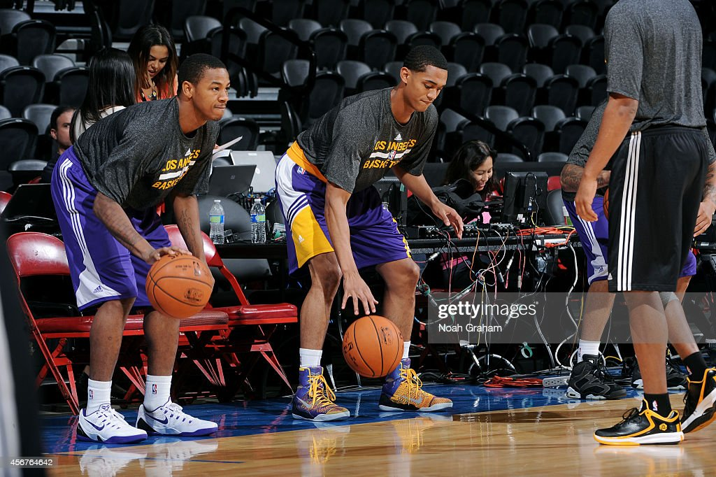 Keith Appling and Jordan Clarkson of the Los Angeles Lakers warms up before a game against the Denver Nuggets at the Valley View Sports Arena in San...