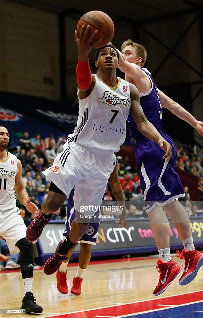 Keith Appling of the Erie BayHawks gets a shot off in front of Nate Wolters of the Grand Rapids Drive during a NBA Development League game on April 3...