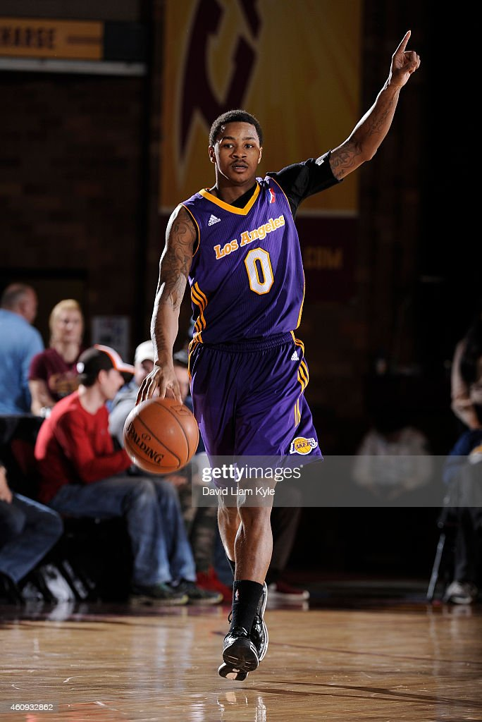 Keith Appling of the Los Angeles DFenders calls out the play as he brings the ball up the court against the Canton Charge at the Canton Memorial...