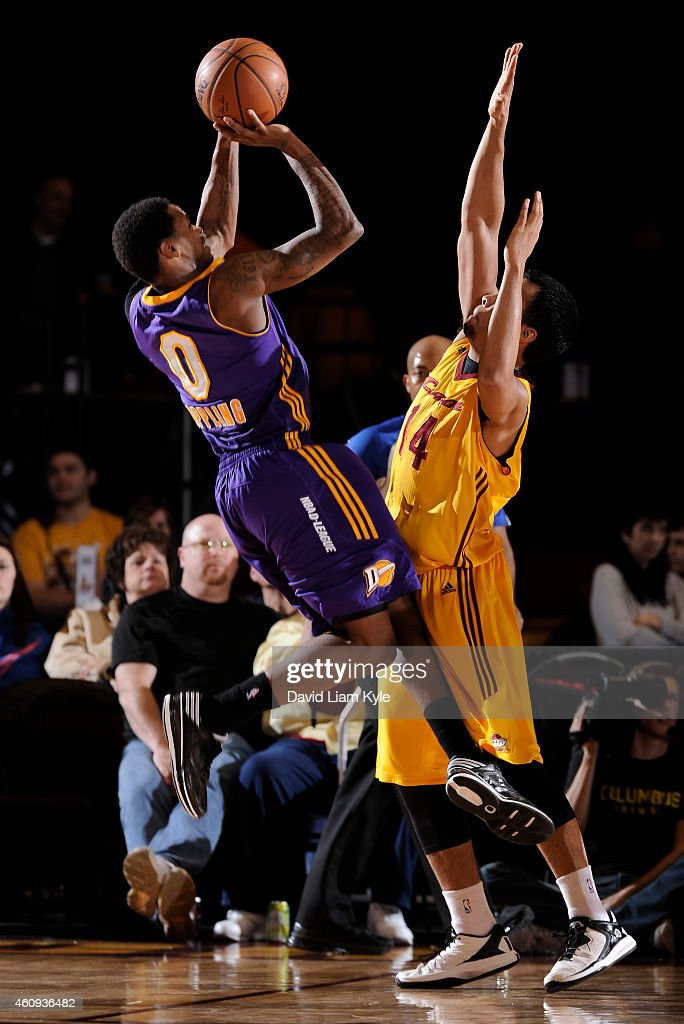 Keith Appling of the Los Angeles DFenders goes up for the shot against Stephen Holt of the Canton Charge at the Canton Memorial Civic Center on...