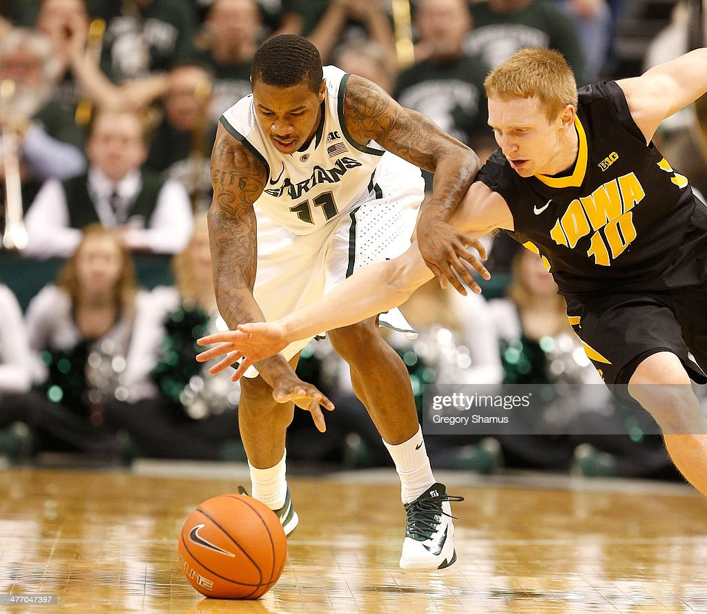 Keith Appling #11 of the Michigan State Spartans battles for the ball with Mike Gesell #10 of the Iowa Hawkeyes during the second half at the Jack T. Breslin Student Events Center on February 6, 2014 in East Lansing, Michigan. Michigan State won the game 86-76.