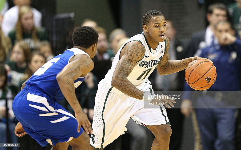 Keith Appling #11 of the Michigan State Spartans brings the ball up the court during the second half of the game against the New Orleans Privateers at the Breslin Center on December 28, 2013 in East Lansing, Michigan. The Spartans defeatede the Privateers 101-48.
