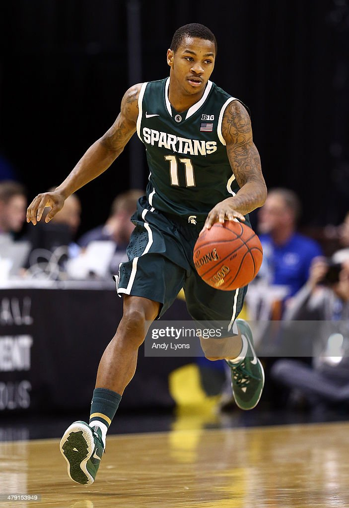 <a gi-track='captionPersonalityLinkClicked' href=/galleries/search?phrase=Keith+Appling&family=editorial&specificpeople=7367720 ng-click='$event.stopPropagation()'>Keith Appling</a> #11 of the Michigan State Spartans brings the ball up the floor against the Michigan Wolverines during the 2014 Big Ten Men's Championship at Bankers Life Fieldhouse on March 16, 2014 in Indianapolis, Indiana.