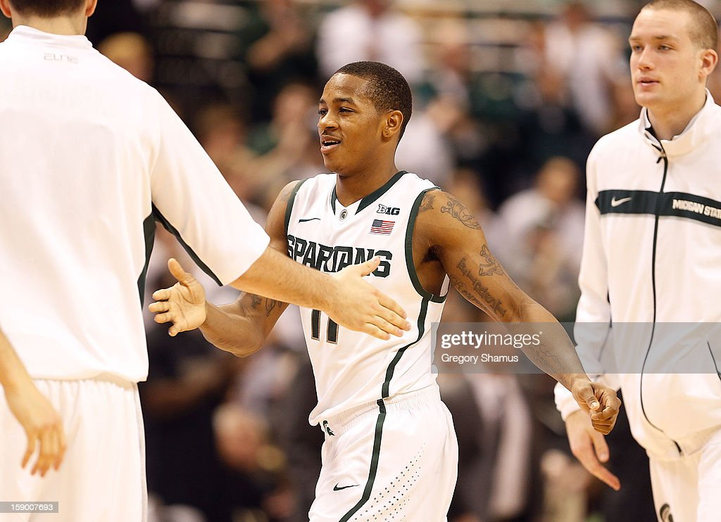 Keith Appling #11 of the Michigan State Spartans celebrates during a first half timeout with teammates while playing the Purdue Boilermakers at the Jack T. Breslin Student Events Center on January 5, 2013 in East Lansing, Michigan. Michigan State won the game 84-61.