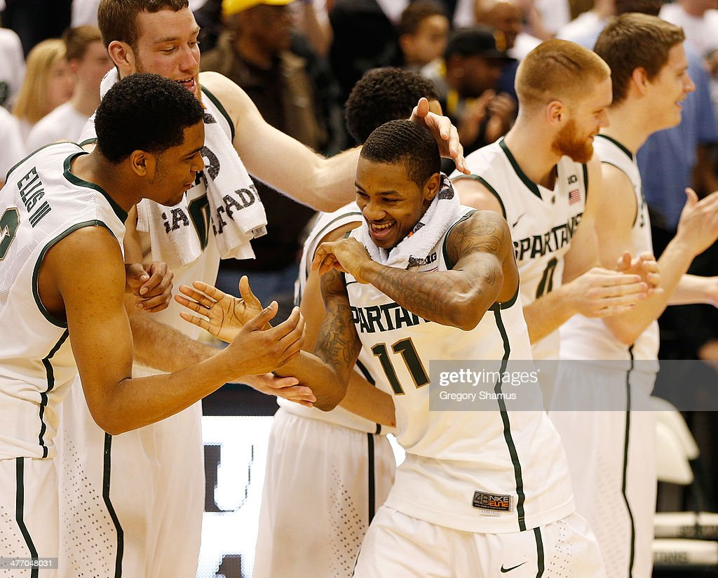 Keith Appling #11 of the Michigan State Spartans celebrates Senior Day with his teammates after defeating the Iowa Hawkeyes 86-76 at the Jack T. Breslin Student Events Center on February 6, 2014 in East Lansing, Michigan.