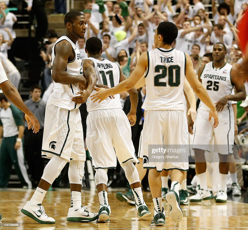 Keith Appling #11 of the Michigan State Spartans celebrates with Branden Dawson #22 and Travis Trice #20 during action against the Ohio State Buckeyes at the Jack Breslin Center on January 19, 2013 in East Lansing, Michigan. Michigan State won the game 59-56.