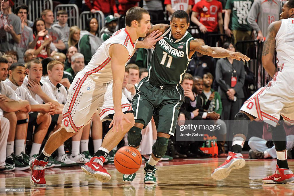 Keith Appling #11 of the Michigan State Spartans defends against Aaron Craft #4 of the Ohio State Buckeyes on February 24, 2013 at Value City Arena in Columbus, Ohio.