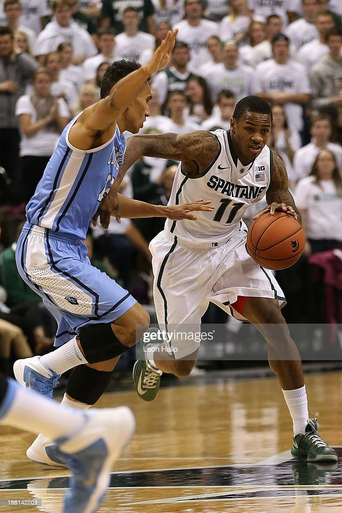 Keith Appling #11 of the Michigan State Spartans drives the ball to the basket as Maodo Lo #12 of the Columbia Lions defends during the game at Breslin Center on November 15, 2013 in East Lansing, Michigan. Michigan State defeated Columbia 62-53.