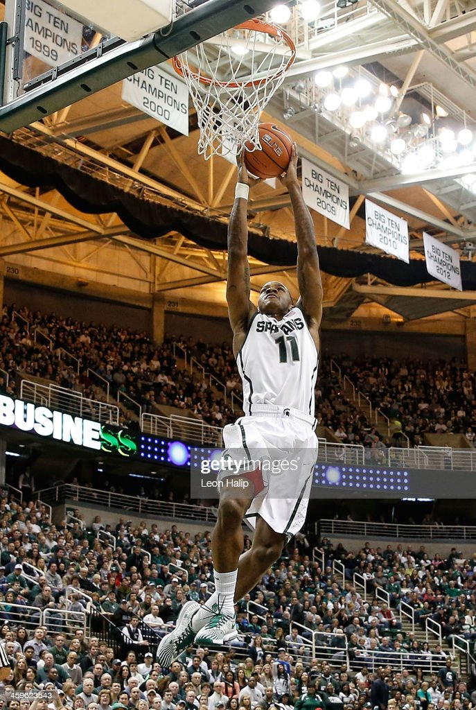 Keith Appling #11 of the Michigan State Spartans drives the ball to the basket during the second half of the game against the New Orleans Privateers at the Breslin Center on December 28, 2013 in East Lansing, Michigan. The Spartans defeatede the Privateers 101-48.