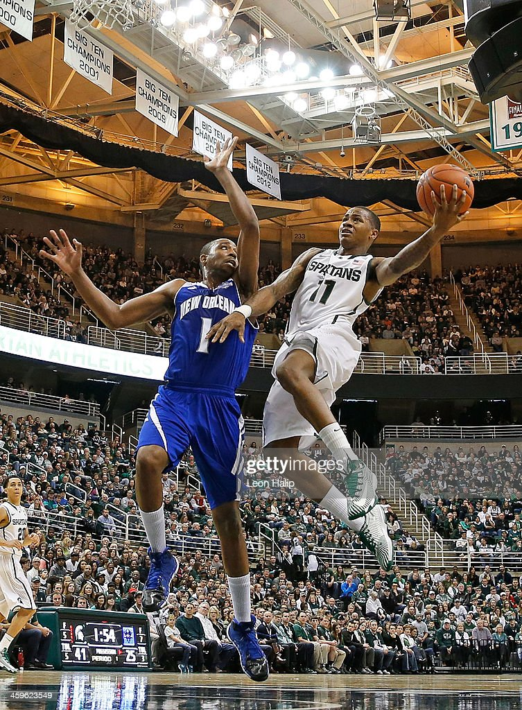 Keith Appling #11 of the Michigan State Spartans drives the ball to the basket during the second half of the game as Tevin Broyles #1 of the New Orleans Privateers at the Breslin Center on December 28, 2013 in East Lansing, Michigan. The Spartans defeatede the Privateers 101-48.