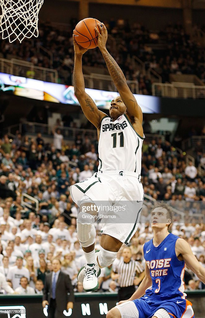 Keith Appling #11 of the Michigan State Spartans gets in for a dunk in front of Anthony Drmic #3 of the Boise State Broncos at the Breslin Center on November 20, 2012 in East Lansing, Michigan. Michigan State won the game 74-70.