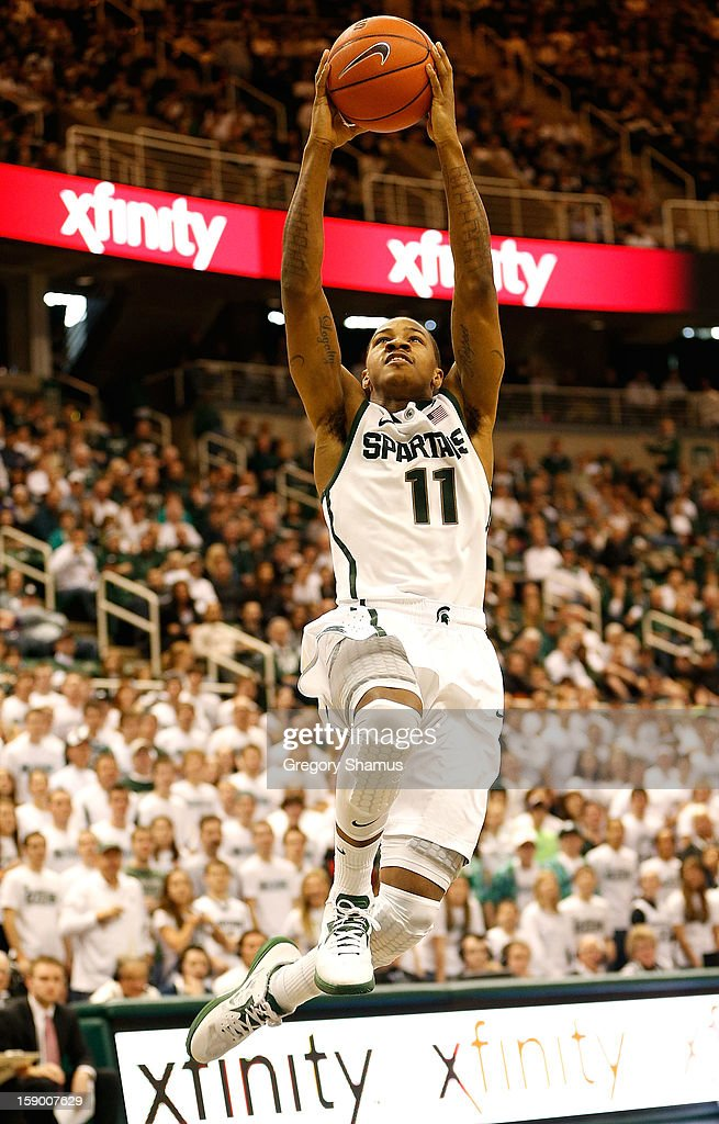 Keith Appling #11 of the Michigan State Spartans gets in for a second half layup while playing the Purdue Boilermakers at the Jack T. Breslin Student Events Center on January 5, 2013 in East Lansing, Michigan. Michigan State won the game 84-61.
