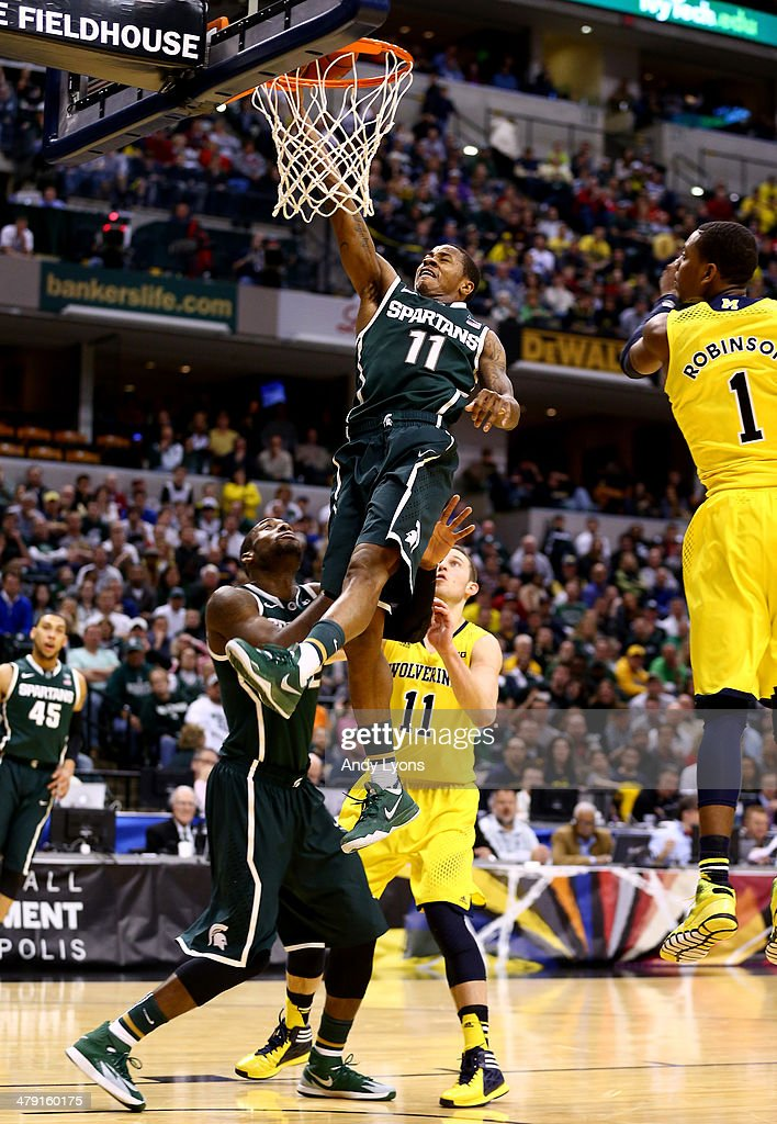 Keith Appling of the Michigan State Spartans goes to the basket against the Michigan Wolverines during the 2014 Big Ten Men's Championship at Bankers...