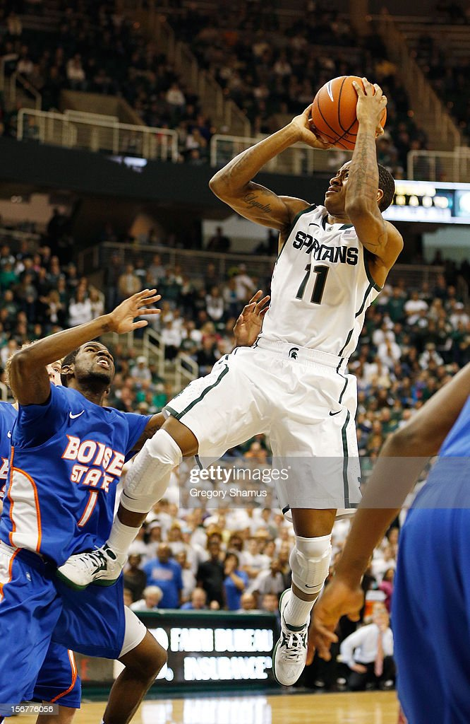 Keith Appling #11 of the Michigan State Spartans hits a late second half shot to seal the game in front of Mikey Thompson #1 of the Boise State Broncos at the Breslin Center on November 20, 2012 in East Lansing, Michigan. Michigan State won the game 74-70. Photo by Gregory Shamus/Getty Images)