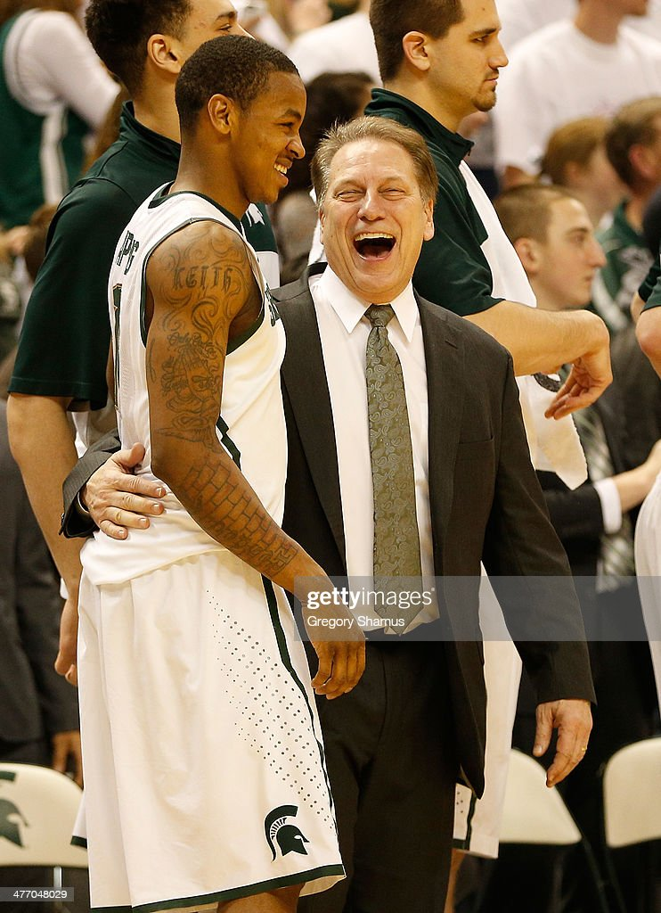 Keith Appling #11 of the Michigan State Spartans laughs with head coach <a gi-track='captionPersonalityLinkClicked' href=/galleries/search?phrase=Tom+Izzo&family=editorial&specificpeople=238861 ng-click='$event.stopPropagation()'>Tom Izzo</a> after leaving the game on Senior Day while playing the Iowa Hawkeyes at the Jack T. Breslin Student Events Center on February 6, 2014 in East Lansing, Michigan.