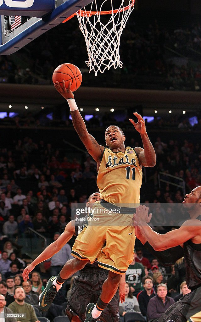Keith Appling #11 of the Michigan State Spartans puts the ball up to the basket against the Georgetown Hoyas during the game at Madison Square Garden on February 1, 2014 in New York City.