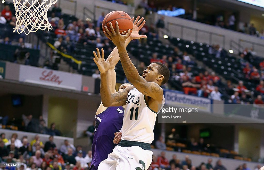 Keith Appling of the Michigan State Spartans shoots the ball in the game against the Northwestern Wildcats during the Quarterfinals of the Big Ten...