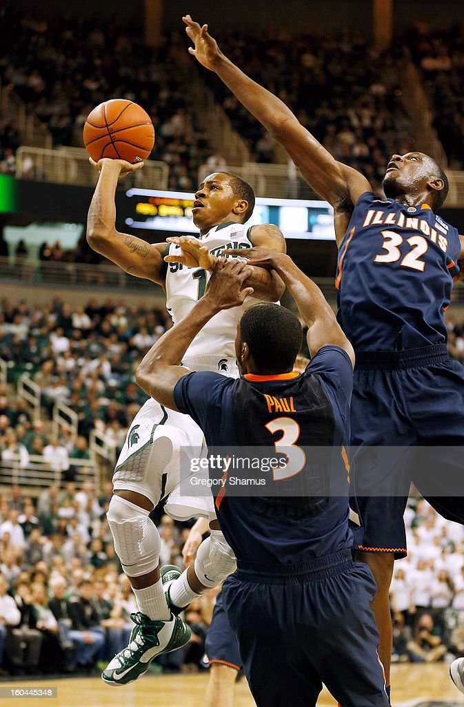 Keith Appling #11 of the Michigan State Spartans tries to get a first half shot off between Nnanna Egwu #32 and Brandon Paul #3 of the Illinois Fighting Illini at the Jack T. Breslin Student Events Center on January 31, 2013 in East Lansing, Michigan. Michigan State won the game 80-75.