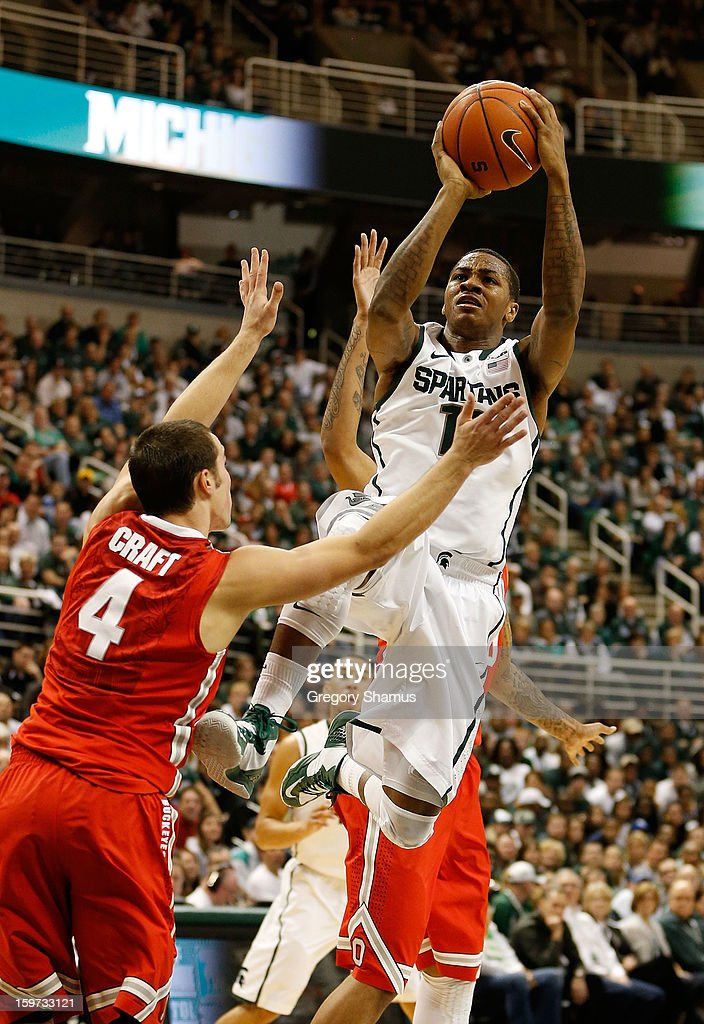 Keith Appling #11 of the Michigan State Spartans tries to get off a first-half shot against Aaron Craft #4 of the Ohio State Buckeyes at the Jack Breslin Center on January 19, 2013 in East Lansing, Michigan.