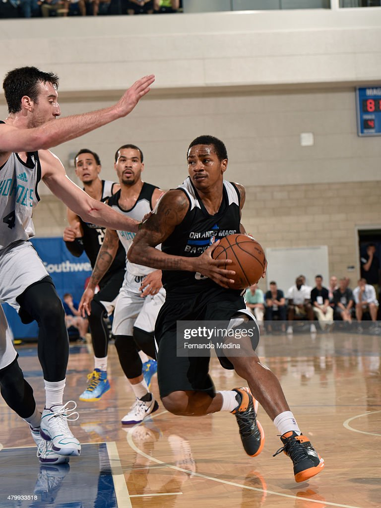 Keith Appling of the Orlando Magic drives to the basket against the Charlotte Hornets on July 8 2015 at Amway Center in Orlando Florida NOTE TO USER...