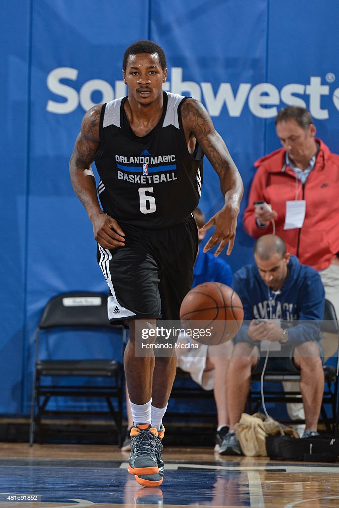 Keith Appling of the Orlando MagicWhite dribbles the ball against the Memphis Grizzlies during the Orlando Summer League on July 8 2015 at Amway...