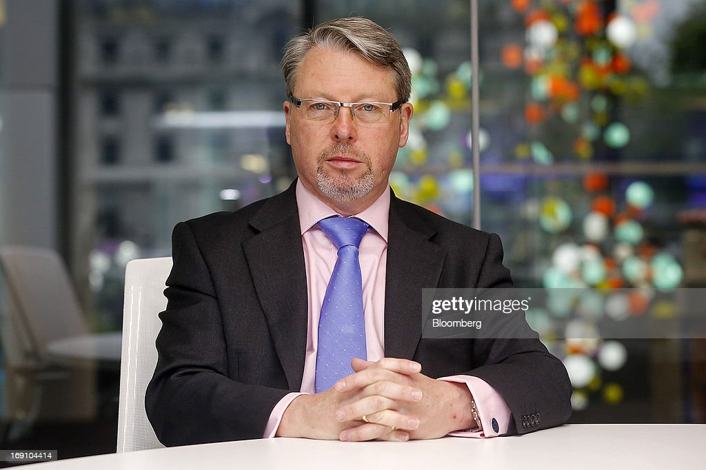 Keith Attwood, chief executive officer of E2V Technologies Plc, poses for a photograph following a Bloomberg Television interview in London, U.K., on Monday, May 20, 2013. Gross domestic product rose 0.3 percent in the first quarter, and surveys this month indicated businesses from banks to airlines strengthened in April, while strains in manufacturing and construction eased. Photographer: Simon Dawson/Bloomberg via Getty Images