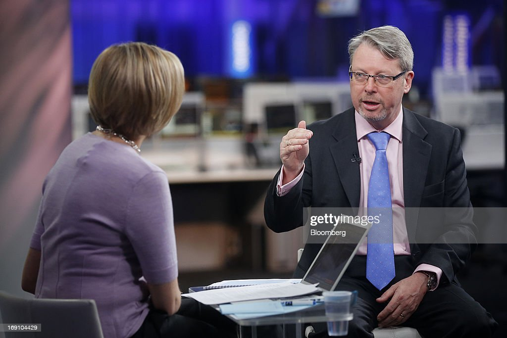 Keith Attwood, chief executive officer of E2V Technologies Plc, right, gestures during a Bloomberg Television interview in London, U.K., on Monday, May 20, 2013. Gross domestic product rose 0.3 percent in the first quarter, and surveys this month indicated businesses from banks to airlines strengthened in April, while strains in manufacturing and construction eased. Photographer: Simon Dawson/Bloomberg via Getty Images