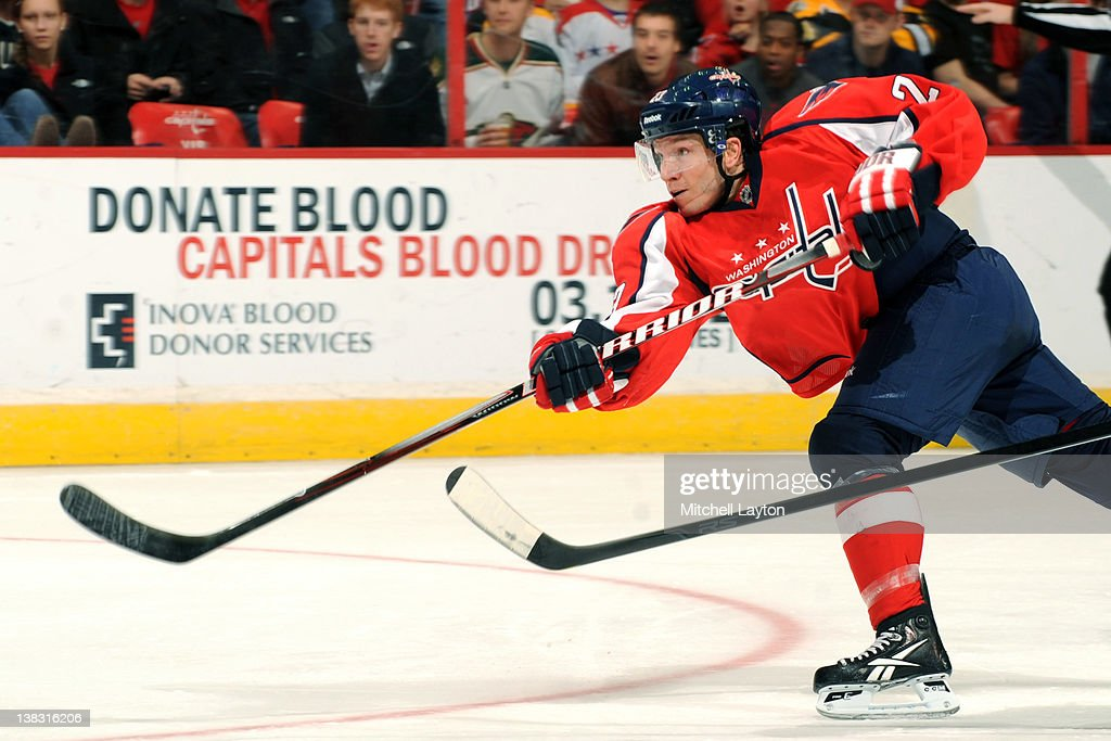 <a gi-track='captionPersonalityLinkClicked' href=/galleries/search?phrase=Keith+Aucoin&family=editorial&specificpeople=2125652 ng-click='$event.stopPropagation()'>Keith Aucoin</a> 239 of the Washington Capitals takes a shot during an NHL hockey game against the Boston Bruins on February 5, 2012 at the Verizon Center in Washington, DC.