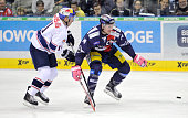 Keith Aucoin of EHC Red Bull Muenchen and Andre Rankel of the Eisbaeren Berlin fight for the puck during the game between the Eisbaeren Berlin and...