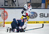 Keith Aucoin of EHC Red Bull Muenchen and Marcel Noebels of the Eisbaeren Berlin during the game between EHC Red Bull Muenchen and the Eisbaeren...